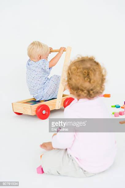 Two baby boys playing