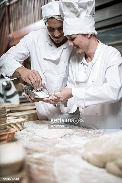 Two bakers working together