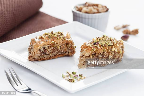 Two baklavas with white background
