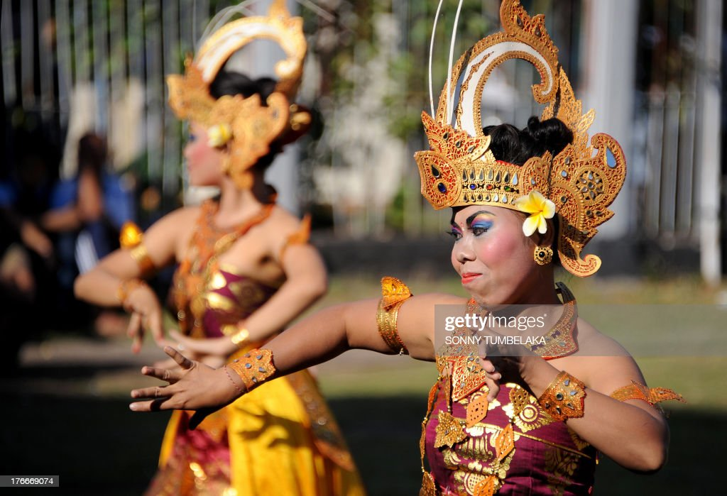 Two Balinese dancers participate in official ceremonies and games marking Indonesia's 68th Independence Day at Kerobokan prison in Denpasar on Indonesia's resort island of Bali on August 17, 2013. Indonesia officials annually offer remissions to some prison sentences on the country's Independence Day for good behaviour. Bali's notorious Kerobokan prison is well known as the place holding several foreign inmates held for high-profile drugs offences.
