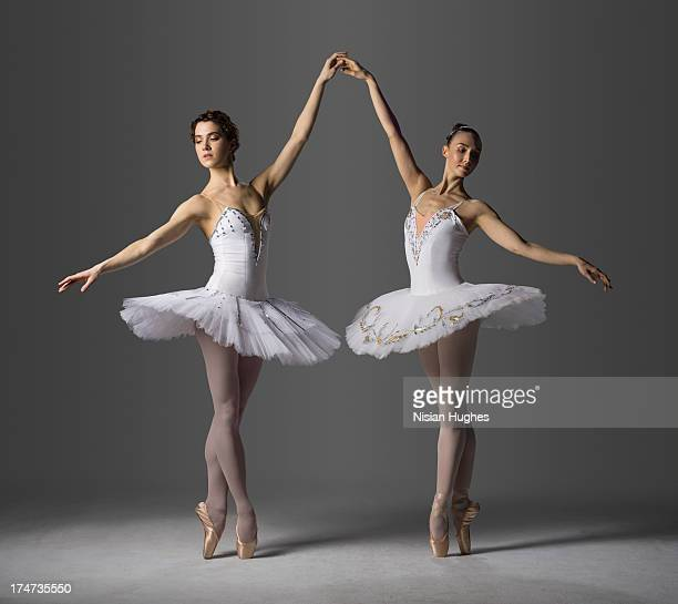 Two ballerinas performing Relevé on Pointe 5th