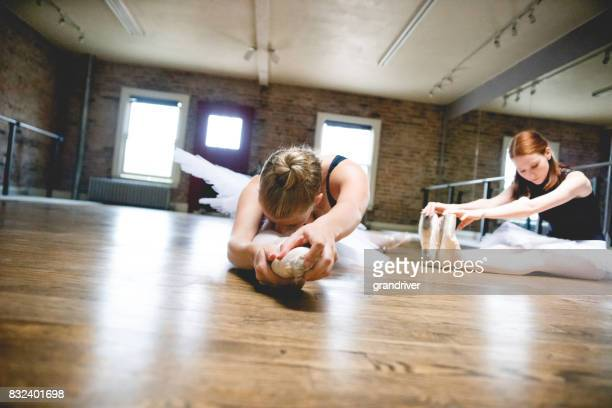 Two Ballerinas Stretching floor stretching
