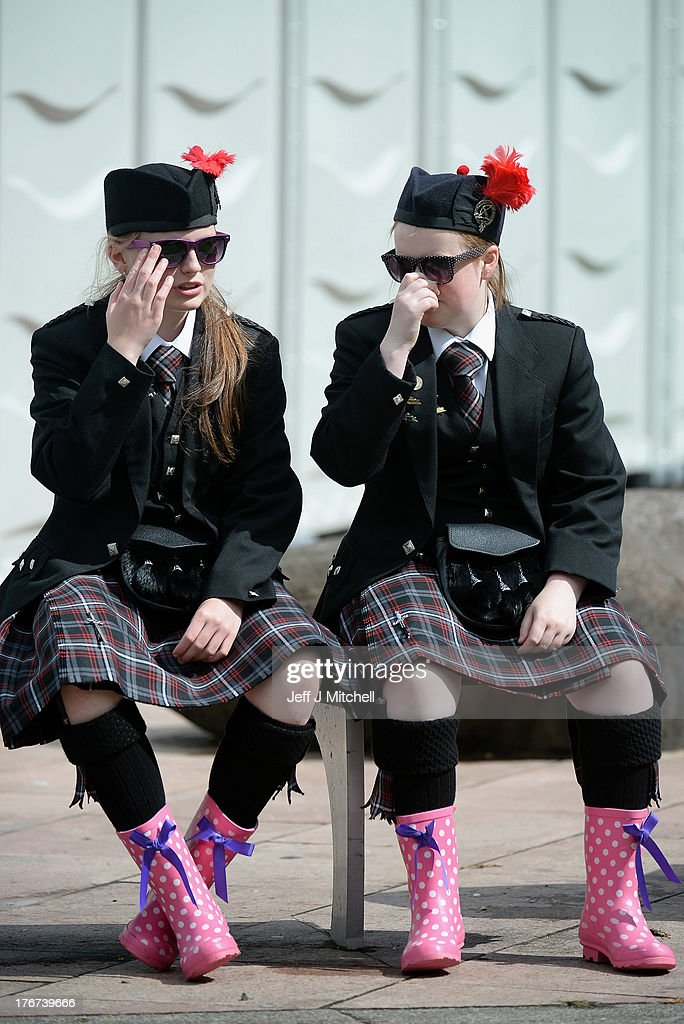 Two band members wear wellies as pipe bands take part in 2013 World Pipe Band Championships at Glasgow Green on August 18,2013 in Glasgow,Scotland. The World Pipe Band Championships has returned to Glasgow this weekend, with 225 pipe bands competing for the title.