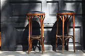 Two vintage wooden bar stools in the pub