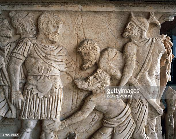 Two barbarians kneeling before the Roman emperor detail from a relief side wall of a Roman sarcophagus ca 190 Monumental Cemetery Pisa Tuscany Italy...