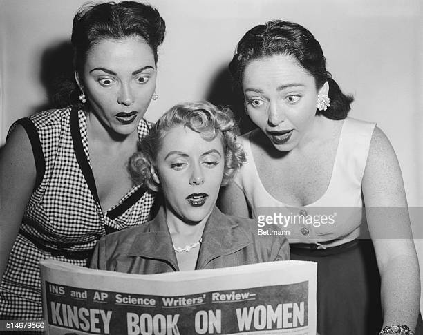 Two Barry sisters read review of Alfred Kinsey Report on Women over the shoulder of Beverly Lawrence
