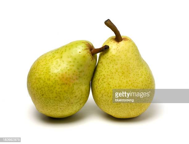 Two bartlett pears leaning on each other