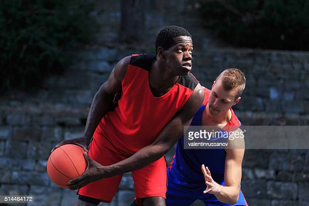Two basketball players in defence