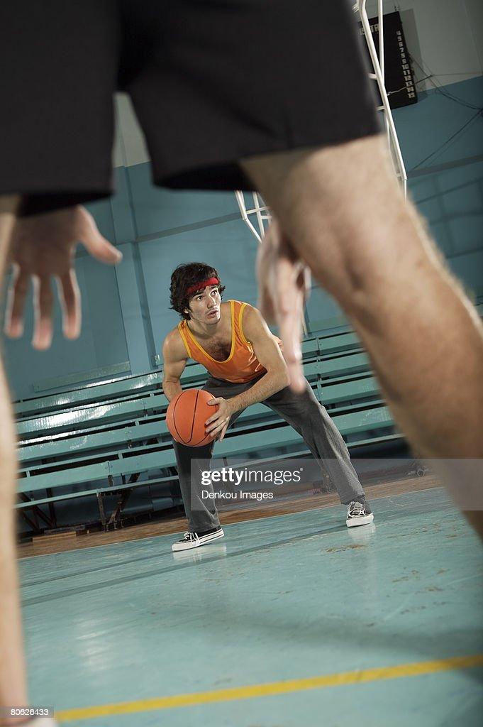 Two basketball players playing basketball : Stock Photo