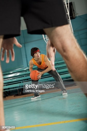 Two basketball players playing basketball : Stock Photo