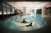 Two bathers enjoy the facilities in the Minerva pool inside the Thermal Bath Spa complex as it prepares to open to the public on August 2 2006 in...