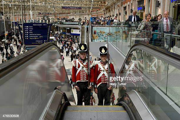 Two Battle of Waterloo reenactors travel up the escalators at Waterloo Station after they attended the unveiling of a memorial plaque by the current...
