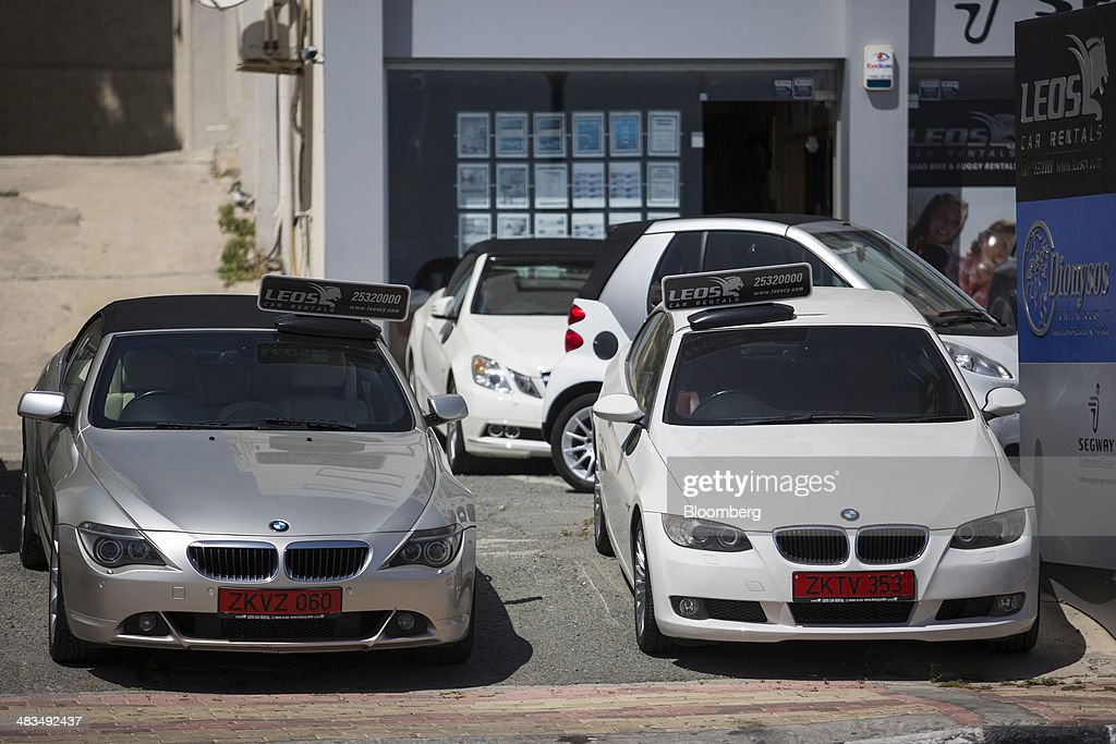 Two Bayerische Motoren Werke AG (BMW) automobiles stand on the forecourt of a luxury car dealership in Limassol, Cyprus, on Tuesday, April 8, 2014. Cyprus wants to shield financial flows with Russia, where it's the biggest foreign investor, as the U.S. and the European Union ratchet up sanctions in response to President Vladimir Putin's annexing Crimea from Ukraine. Photographer: Andrew Caballero-Reynolds/Bloomberg via Getty Images