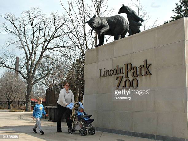 Two bear statues look down on passersby at the entrance to the Lincoln Park Zoo in Chicago Illinois Wednesday March 8 2006