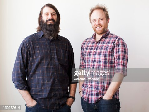 Two bearded males posing together