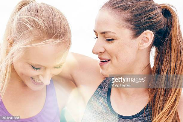 two beautiful female athletes laughing together