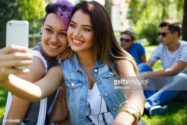 Two beautiful friend taking selfie