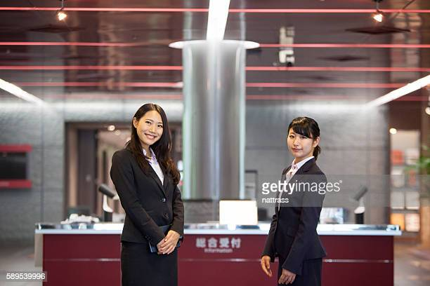 Two Beautiful Japanese women await at reception desk