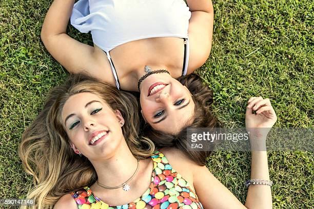 Two beautiful teens enjoy outdoor