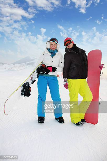 two beautiful woman with snowboard