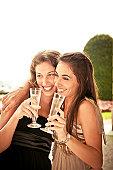 Two beautiful women drinking champagne