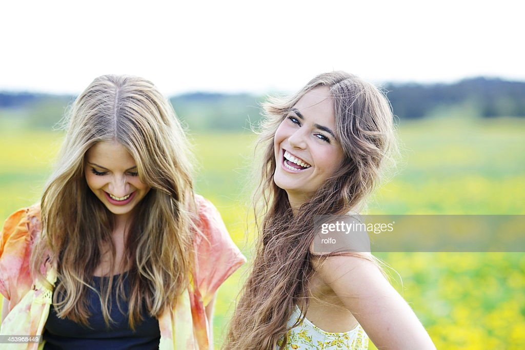 Two beautiful young woman laughing : Stock Photo