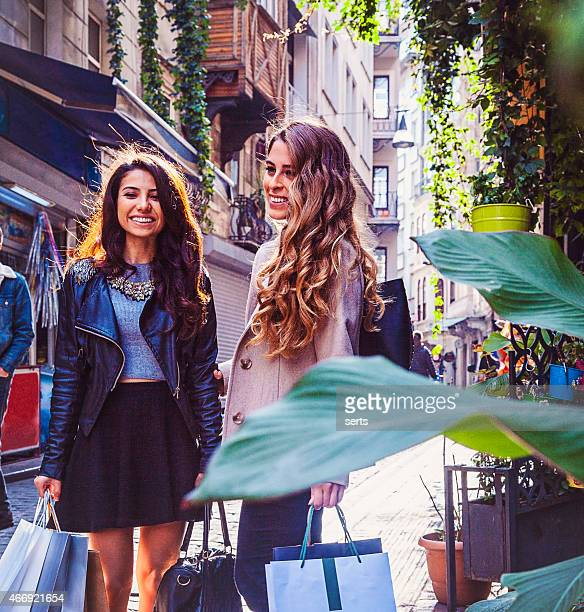 Two beautiful young women enjoying a shopping spree