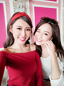 two beauty woman selfie happily in the restaurant