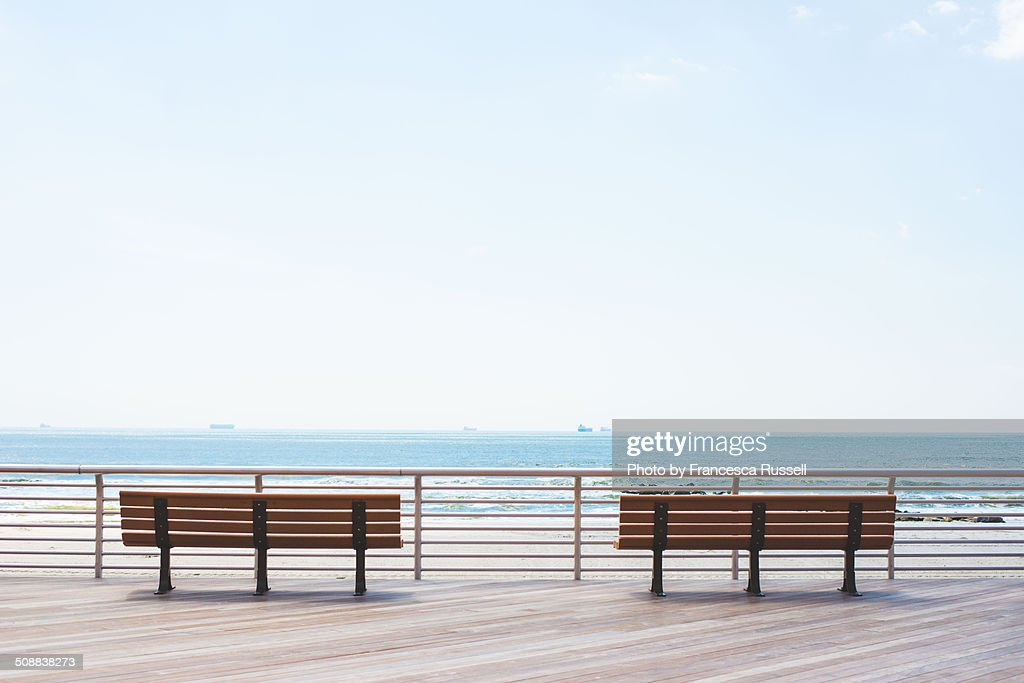 Two benches on the boardwalk.