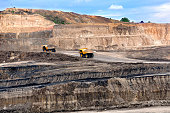 Two big truck on open pit hauling marerial overburden,  on open pit