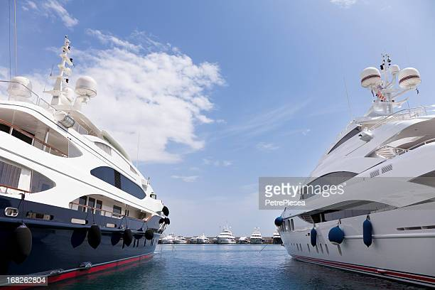 Two big yachts in the marina. Summer season.