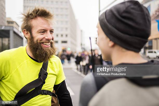 Two bike messengers chatting