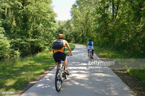 Two bikers on Via Rhona bicycle lane