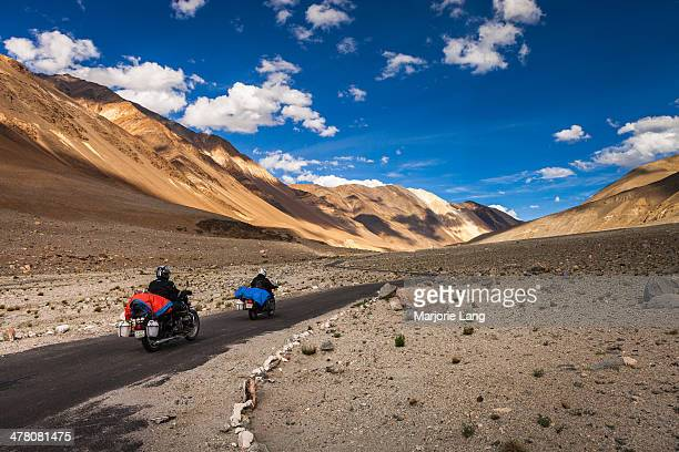 CONTENT] Two bikers traveling the idyllic landscapes of Ladakh by the Himalaya mountains riding their Royal Enfield motorcycles towards the Changtang...