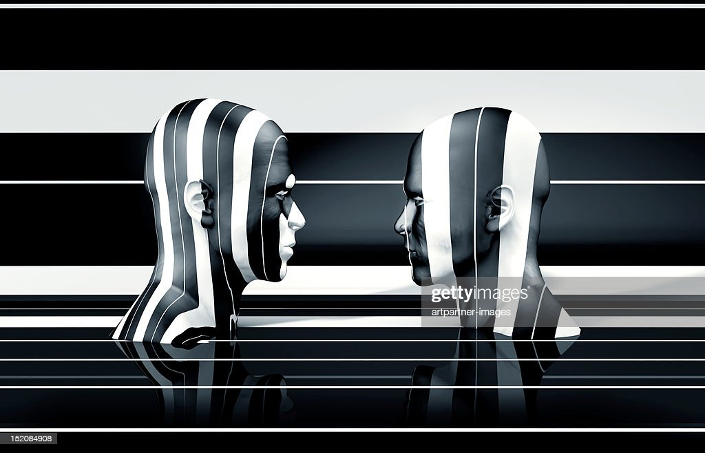 Two black and white striped human heads : Stock Photo