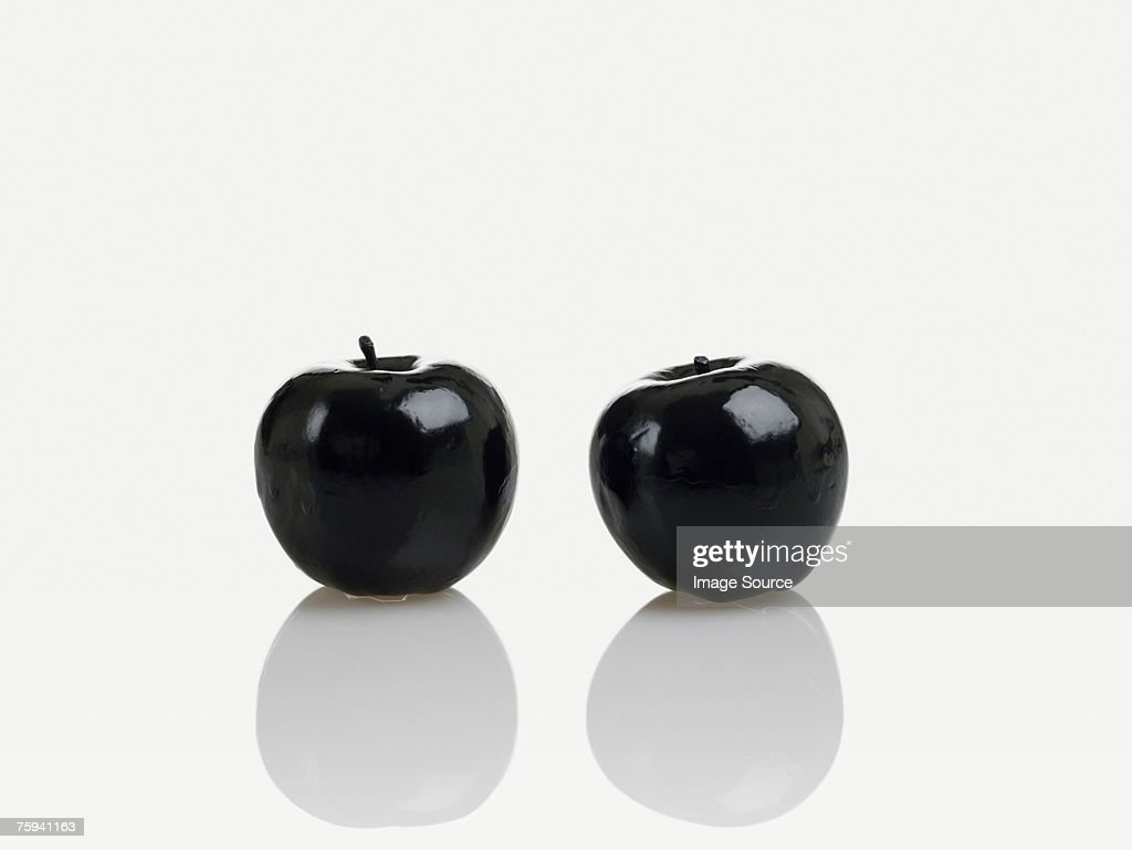 Two black apples : Stock Photo