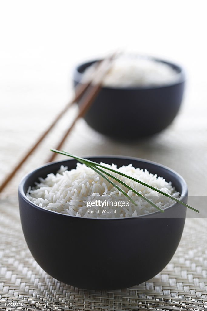 Two black bowls of rice : Stock Photo