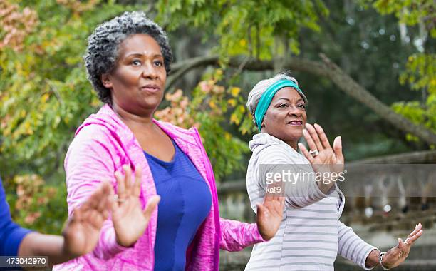 Two black women practicing Tai Chi