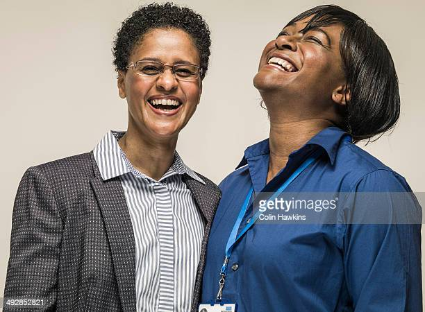 Two black work colleagues laughing