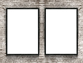 Two blank banners with wooden frame on brick wall background