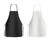 Two blank black and white aprons isolated on white. 3d illustration
