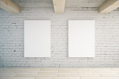 Two blank posters in room with brick wall and wooden floor. Mock up, 3D Rendering