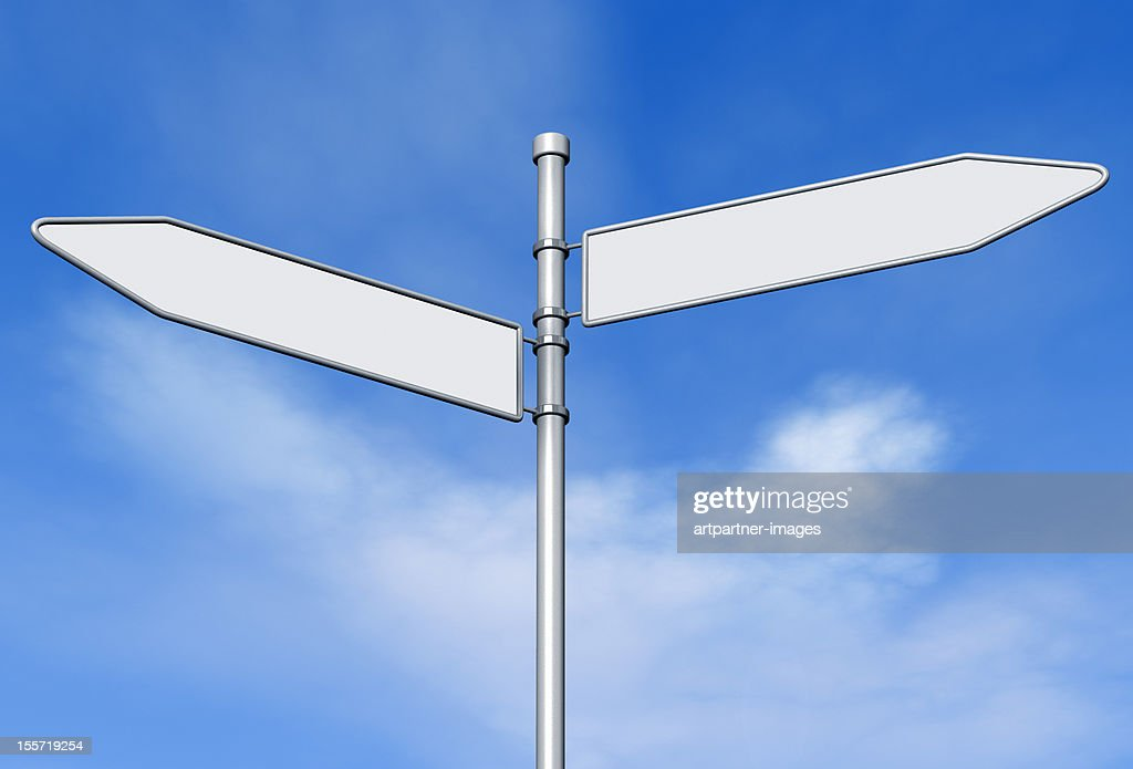 Two blank signs on a signpost against blue sky : Stock Photo