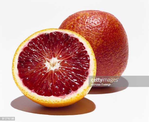 Two blood orange fruits