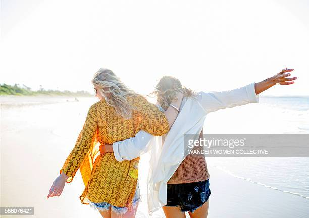 Two Bohemian girls on beach carefree and happy