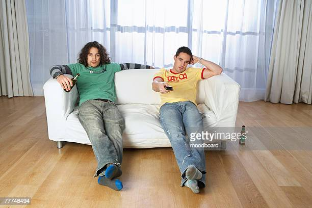 Two Bored Men Watching Television
