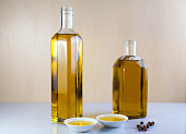 Two bottle olive oil with two test plate and Peppercorns on brown and white