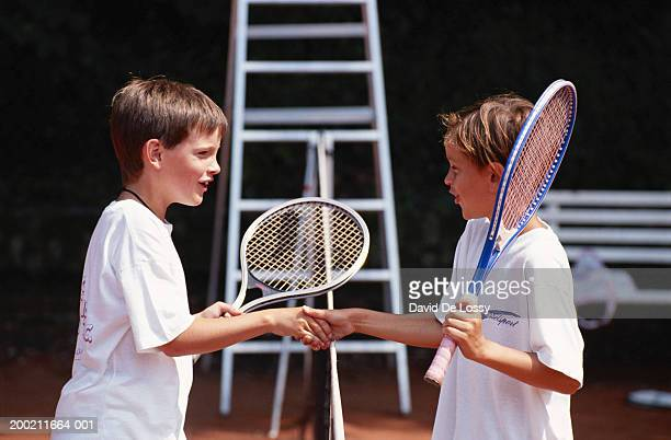 Two boy shaking hand