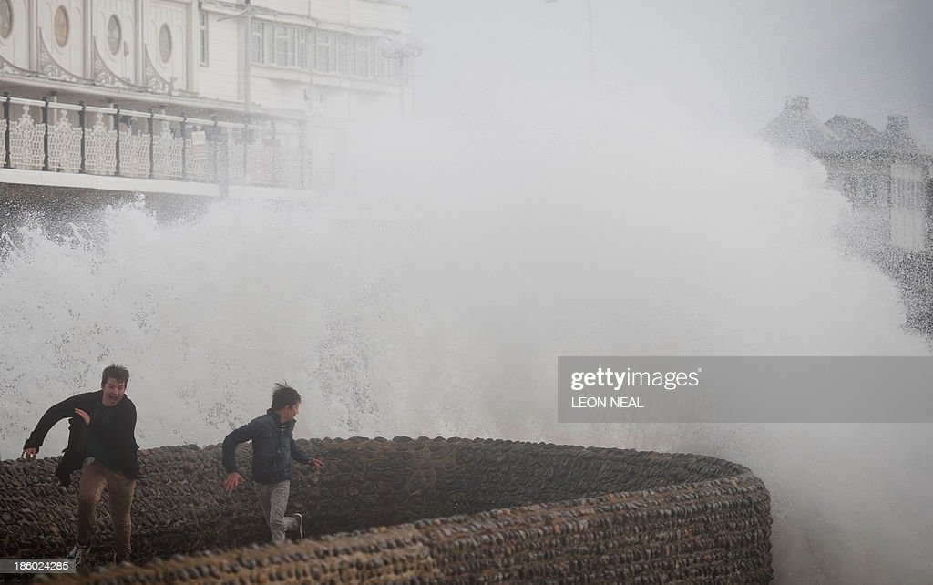 Two boys attempt to evade the spray as large waves crash against the walls of Brighton seafront, in southern England on October 27, 2013 as a predicted storm starts to build. Britain was braced on October 27 for its worst storm in a decade, with heavy rain and winds of more than 80 miles (130 kilometres) an hour set to batter the south of the country.