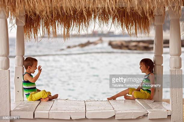 Two boys, brothers, on the beach